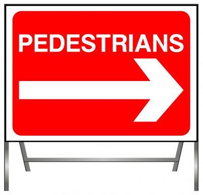 Pedestrians go right sign