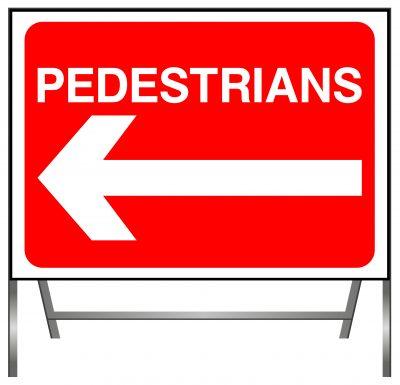 Pedestrians go left sign