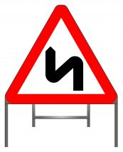 Double bend first to left (symbol may be reversed) warning sign