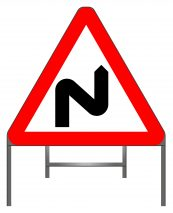 Double bend first to right (symbol may be reversed) warning sign